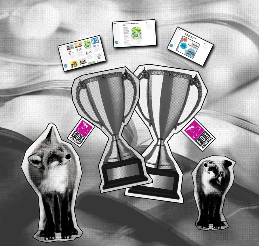 Zwei silberne Pokale sowie zwei silberne Füchse.
